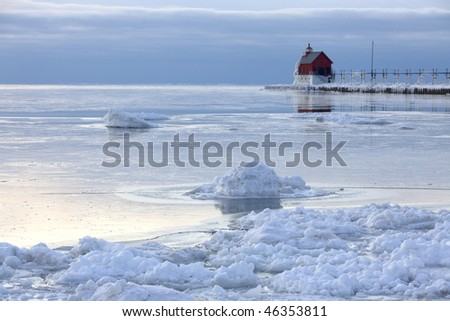See the lighthouse in Grand Haven, Michigan at sunset from distance - stock photo