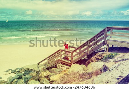 see view with lady in red  on wooden staircase in retro style - stock photo