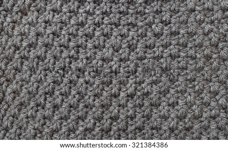 Seed stitch in grey yarn as an abstract background texture - stock photo