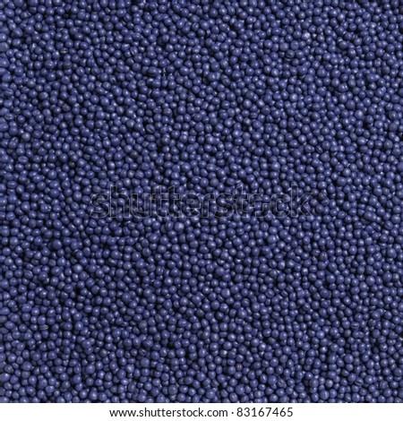 Seed treater, macro rape seeds texture - stock photo