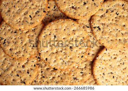 Seeded round crackers for snacking. - stock photo