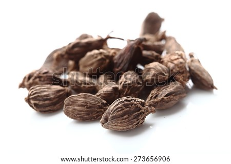 Seeds of black cardamom isolated on white background - stock photo