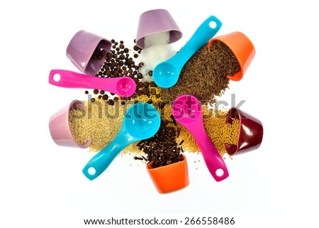 Seeds, spices, grains woken and mixed with each other on a white background - stock photo