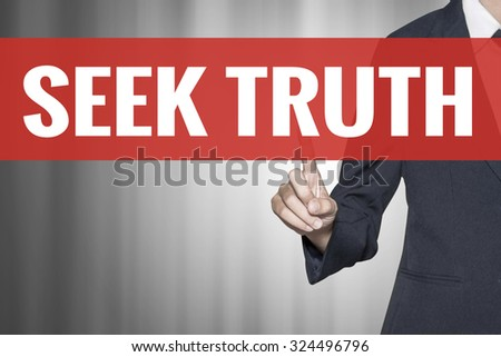 Seek Truth word on virtual screen push by business woman red tab - stock photo