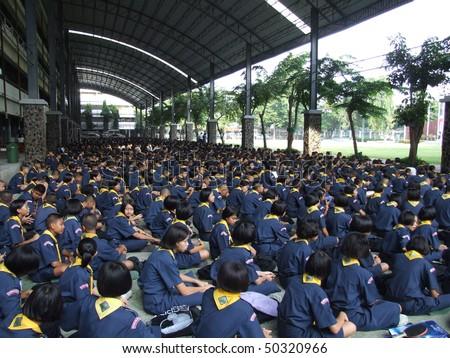 SEEKAN SCHOOL, BANGKOK, THAILAND- MAY 11: Students sit in morning assembly in the school yard. Seekan School, Don Muang in May 11 2005 in Bangkok. - stock photo