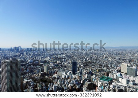 Seen from Ikebukuro Fuji and Tokyo downtown streets Shinjuku skyscrapers right to Ikebukuro Station on the left - stock photo