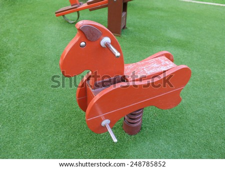 Seesaw in the shape of the horses for the playground - stock photo
