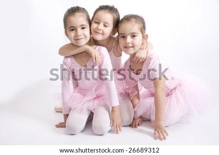 seet friends.Little ballerina girl hug her friends - stock photo