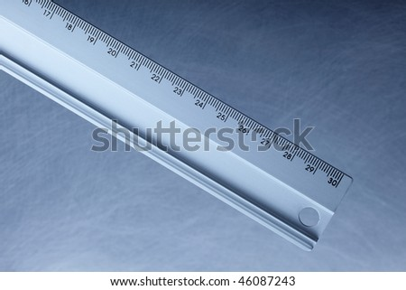 segment of a metal ruler on white - stock photo