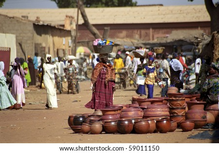 SEGOU, MALI - JANUARY 16: Fulani woman visits the market at January 16, 2006, Segou, Mali. The local market is a draw for the tribe people. - stock photo