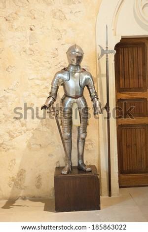 SEGOVIA, SPAIN - APR 5, 2014: Armor in the Alcazar of Segovia (Segovia Castle), a stone fortification, Segovia, Spain. It's one of the inspirations for Walt Disney's Cinderella Castle. - stock photo