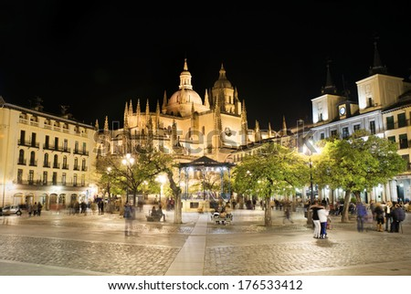 SEGOVIA, SPAIN - FEBRUARY, 14: Segovia main square with the famous cathedral in the background, on February 14 2013. Long exposure picture with unidentified tourists. - stock photo