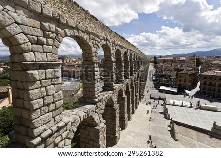 SEGOVIA, SPAIN - SEPTEMBER 14, 2014: The ancient roman aqueduct bridge in Segovia, Spain.  - stock photo