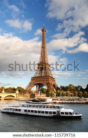Seine in Paris with Eiffel tower against white boat, France - stock photo