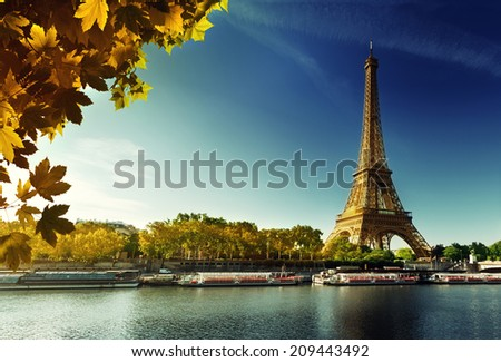 Seine in Paris with Eiffel tower in autumn season - stock photo