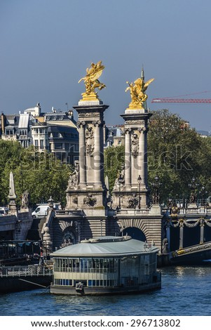 Seine River and famous Alexandre III bridge. The bridge, with its exuberant Art Nouveau lamps, cherubs, nymphs and winged horses at either end, was built between 1896 and 1900. Paris, France. - stock photo