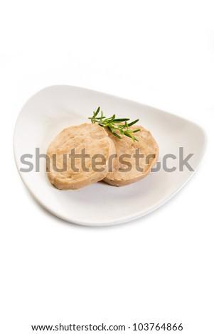 seitan steack over dish on white background - stock photo