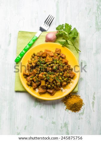 seitan stew with peas and curry, vegetarian food - stock photo