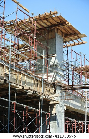 SELANGOR, MALAYSIA -APRIL 13, 2015: Scaffolding as the temporary structure used to support platform, form work and structure at the construction site. Also used it as a walking platform for workers.