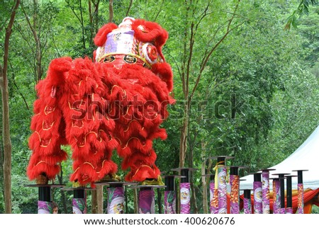 SELANGOR, MALAYSIA -FEBRUARY 18, 2016: The lion dance is a ritual traditions of the Chinese society in Malaysia. The dance is usually played during the Chinese New Year. - stock photo