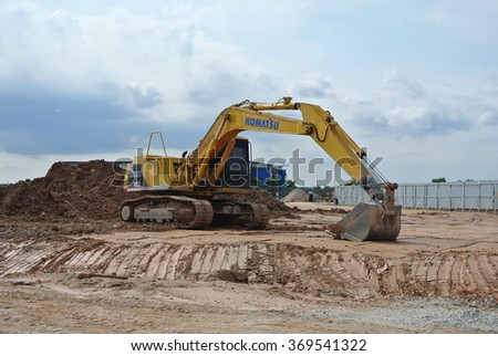 SELANGOR, MALAYSIA â?? MAY 05, 2014: Excavators is heavy construction machine used at the construction site to do the earthworks.