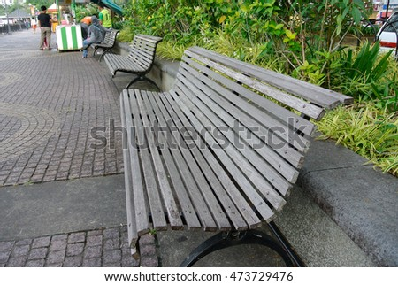SELANGOR, MALAYSIA -MAY 12, 2016: Wooden bench at the public park in Malaysia