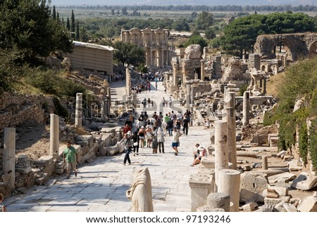 SELCUK, TURKEY - SEP 18: Tourists visit ruins of Ephesus, an ancient major Roman city on Sept 18, 2011 in Selcuk, Turkey. - stock photo