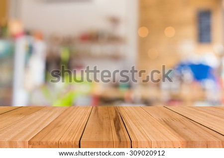 Selected focus empty brown wooden table and Coffee shop blur background with bokeh image for your photomontage or product display. - stock photo