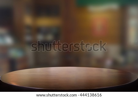 Selected focus empty brown wooden table and space of Coffee shop restaurant blur background with bokeh image, for product display montage.