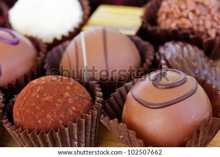 selection of chocolated sweet pralines close up