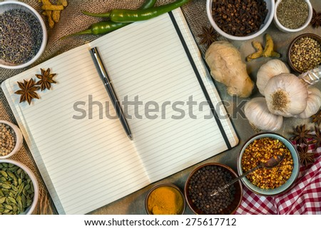 Selection of Cooking Spices with an Open Recipe Book - Blank Pages - Space for Text - stock photo