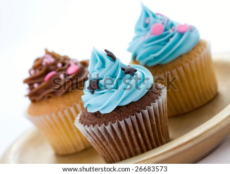 Selection of cupcakes on a plate - stock photo