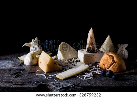 Selection of different cheeses (Russian cheeses) on black background  - stock photo