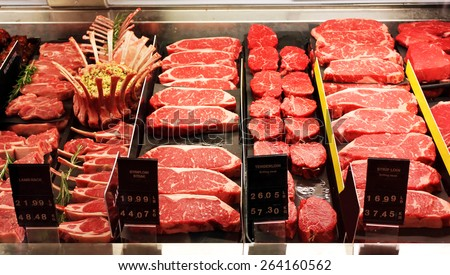 Selection of different cuts of fresh raw red meat in a supermarket - stock photo