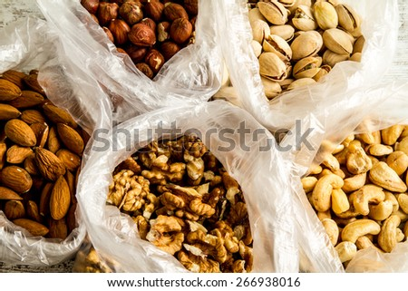 Selection of dried fruits in bags, background  - stock photo