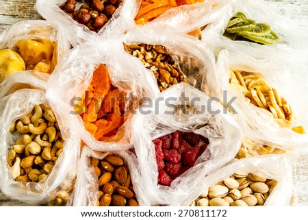 Selection of dried fruits in bags , background - stock photo