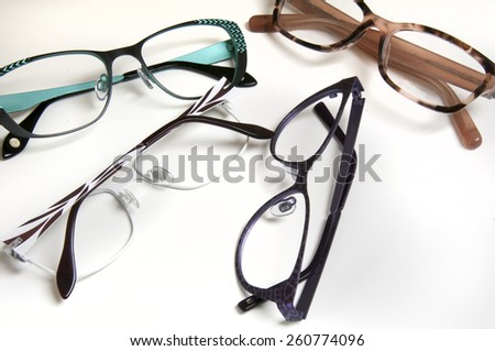 Selection of frames for eye wear purchases at optometrist or vision specialist - stock photo