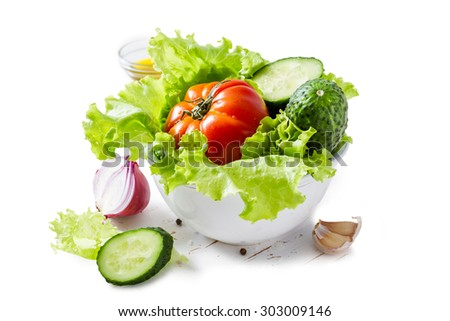 Selection of fresh vegetables in white bowl, isolated on white