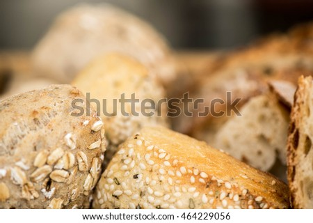 Selection of Freshly Baked Seeded Bread Rolls and White Bread