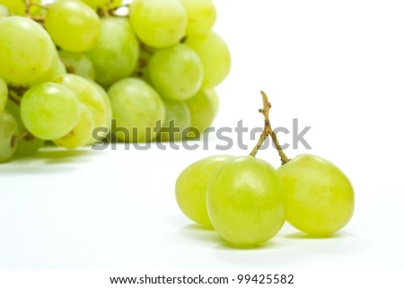 Selection of grapes on a white background - stock photo