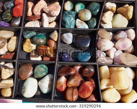 Selection of of semiprecious gemstones for sale in a flea market