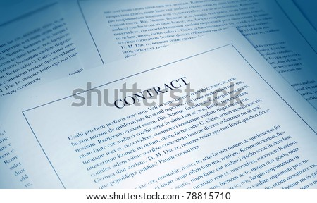 selection of papers with contract in the foreground - stock photo