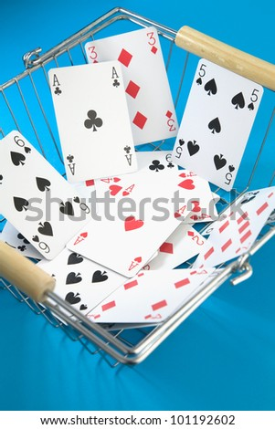 selection of Playing cards in a wire shopping basket