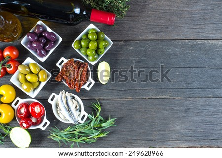 selection of spanish tapas with red wine from above - stock photo