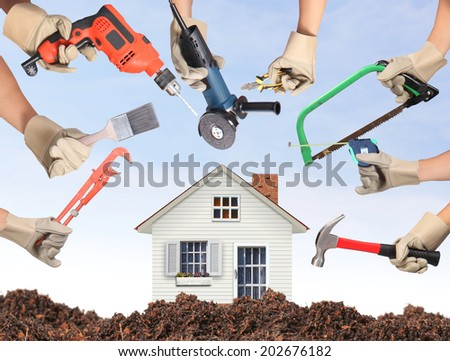 Selection of tools in the shape of a house, home improvement concept  - stock photo