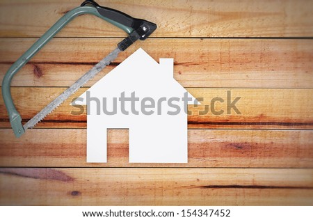 Selection of tools in the shape of a house on wood