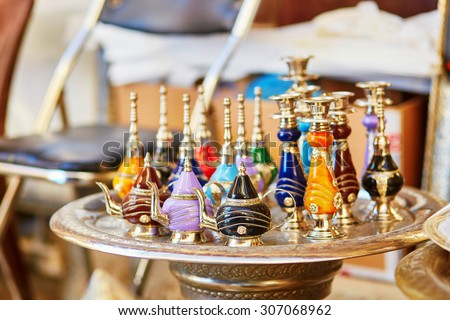 Selection of traditional bottle for perfumes or incenses on Moroccan market (souk) in Fes, Morocco - stock photo