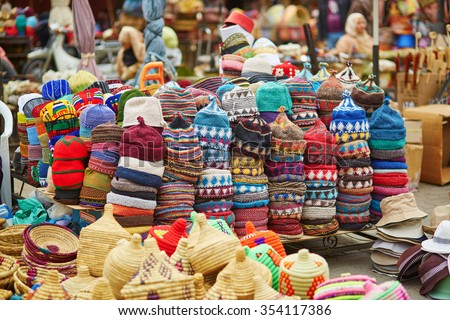 Selection of woolen hats on a traditional Moroccan market (souk) in Marrakech, Morocco - stock photo