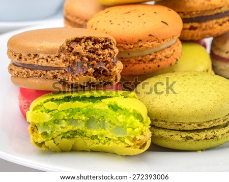 Selective focus bitten macaroons The aroma of sweet macaroons so temptation, cannot resist to taste some - stock photo