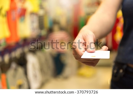 Selective Focus : Close up image of a woman paying with credit card at the store - stock photo